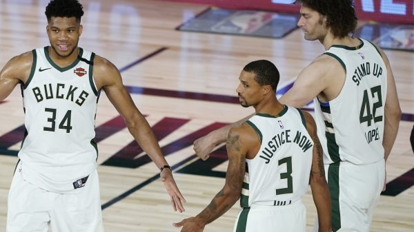 George Hill, Giannis Antetokounmpo and Robin Lopez