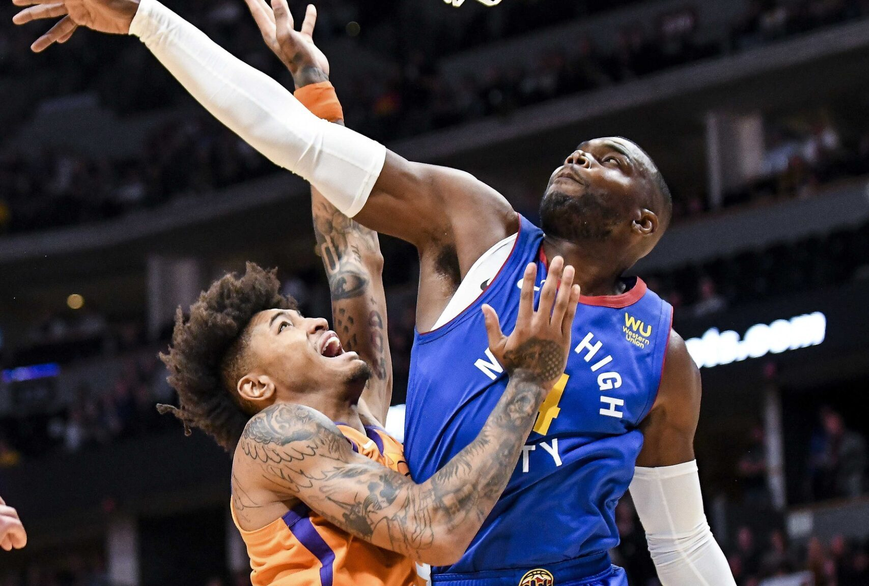 Kelly Oubre Jr. and Paul Millsap